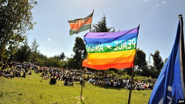 Members of the Kikuyu and Kalenjin tribes are seen gathering for a peace meeting in Eldoret, Kenya, in this June 27, 2009, file photo.