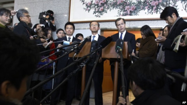 U.S. special envoy to North Korea Glyn Davies, center right, and South Korea's nuclear envoy Lim Sung-nam, center left, listen to reporters question after their meeting at the Foreign Ministry in Seoul, South Korea, December 8, 2011.