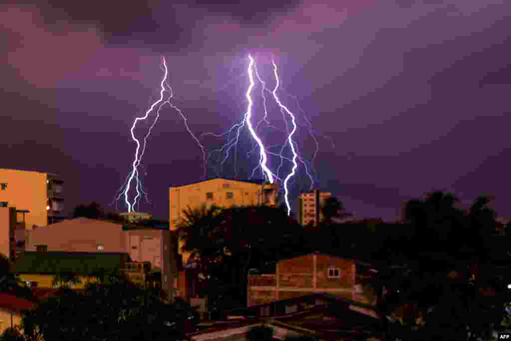 Lightning strikes over a residential area in Yangon, Myanmar.