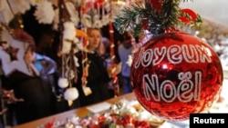 Christmas tree decorations are sold at the Christkindelsmaerik near Strasbourg Cathedral, Nov. 2012.