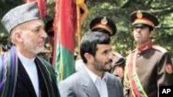 Afghan President Hamid Karzai, left, and Iranian President Mahmoud Ahmadenijad