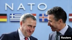 Ukrainian Foreign Minister Andriy Deshchytsia listens to NATO Secretary General Anders Fogh Rasmussen during a NATO-Ukraine foreign ministers meeting at the Alliance headquarters in Brussels April 1, 2014.