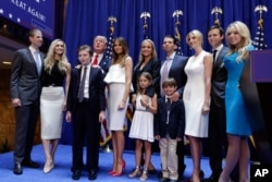FILE - Donald Trump, fourth left, poses with his family after his announcement that he will run for president of the United States, in the lobby of Trump Tower, New York, June 16, 2015.