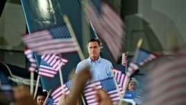 Republican presidential nominee, former Massachusetts Governor Mitt Romney addresses the audience at a rally with the GOP team at the Military Aviation Museum in Virginia Beach, Virginia, September 8, 2012.