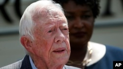 FILE- Former President Jimmy Carter speaks during a news conference, in Plains, Ga., Sept. 18, 2018.