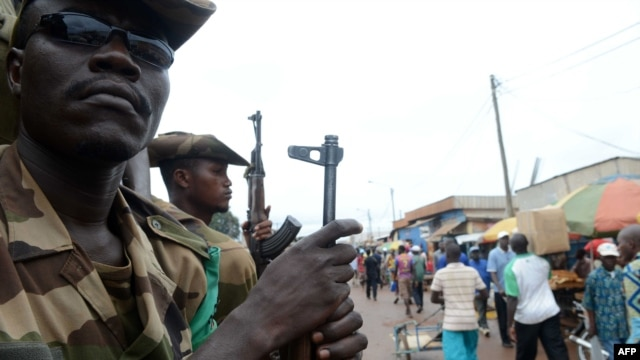 Members of the Multinational Force of Central Africa (FOMAC) patrol on July 20, 2013 in Bangui.