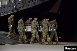 A U.S. Army carry team transfers the remains of Army Staff Sgt. Dustin Wright of Lyons, Georgia, at Dover Air Force Base in Delaware on October 5, 2017.