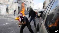 İsrail polisi ile çatışan Filistinli göstericiler