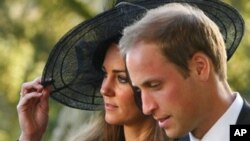 Britain's Prince William and Kate Middleton leave the wedding of their friends Harry Mead and Rosie Bradford in the village of Northleach, England, in this October 23, 2010, file photo. According to an announcement from Clarence House in London, Tuesday