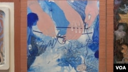The panel of Kyujin Lee shows hands trying to knit an unruly thread. This, she says, shows her own separation from South Korea and how her life has become knitted into the US. (Jsoh/VOA)