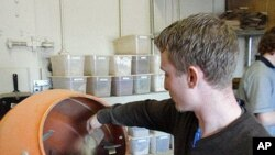 Nate Winkler adds some spices to a mate blend at Oregon Yerba Mate in Redmond, Oregon