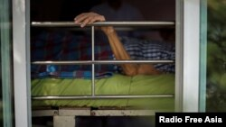 Uthai Sagulpongmalee, 70, lies in bed at Wellness Nursing Home Center in Ayutthaya, Thailand, April 9, 2016.