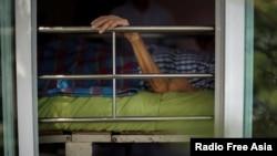Uthai Sagulpongmalee, 70, lies in bed at Wellness Nursing Home Center in Ayutthaya, Thailand, April 9, 2016.