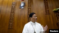 Cardinal Charles Maung Bo gestures during a Reuters interview in his office at Yangon January 6, 2015. Religious extremism could derail Myanmar's much-vaunted reform process, the Buddhist-majority country's first Catholic cardinal, Charles Maung Bo, said