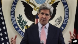 U.S. Senator John Kerry gestures, as he speaks during a press conference at the U.S. embassy in Kabul, Afghanistan, Sunday, May 15, 2011. (AP Photo/Musadeq Sadeq)