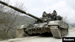 A tank of the self-defense army of Nagorno-Karabakh moves on the road near the village of Mataghis, April 6, 2016.