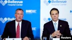 美國紐約州州長安德魯科莫(右)與紐約市市長白思豪(左)。