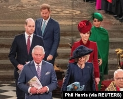 Ratu Inggris Elizabeth II, Pangeran Charles, Camilla, Duchess of Cornwall, Pangeran William dan Catherine, Duchess of Cambridge, Pangeran Harry dan Meghan, Duchess of Sussex menghadiri Commonwealth Service tahunan di Westminster Abbey di London, Inggris 9