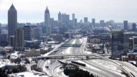 s creating massive traffic jams lasting through Wednesday, Jan. 29, 2014, in Atlanta.
