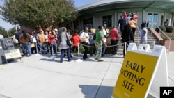 FILE - Voters line up during early voting at Chavis Community Center in Raleigh, N.C., Oct. 20, 2016. Voters in the key presidential battleground of North Carolina demonstrated keen interest on the first day of early voting, as some waited in line for more than an hour Thursday to cast ballots.