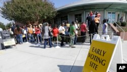 FILE - Voters line up during early voting at Chavis Community Center in Raleigh, North Carolina, Oct. 20, 2016.
