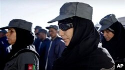 Afghan policewomen attend their graduation ceremony in Herat, west of Kabul, Afghanistan