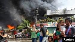 菲律賓三寶顏市在星期四的武裝衝突多處受到炮火破壞