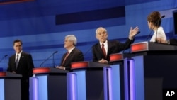 Republican presidential candidates from left, former Massachusetts Gov. Mitt Romney, former House Speaker Newt Gingrich, Rep. Ron Paul, R-Texas, and Rep. Michele Bachmann, R-Minn., participate in a Republican presidential debate in Sioux City, Iowa, Dec.
