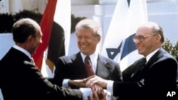 Egyptian President Anwar Sadat, US President Jimmy Carter and Israeli Prime Minister Menachem Begin, White House (March 1979 file photo)