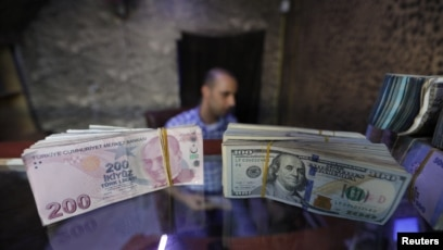 Banknotes Of U S Dollars And Turkish Lira Are Seen In A Currency Exchange The