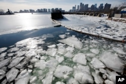 Sea ice floats in Boston Harbor Jan. 3, 2018, in Boston. After a week of frigid temperatures, a major winter storm is predicted for the region on Thursday.