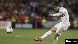Cristiano Ronaldo gets his kick in the Euro 2012 match.