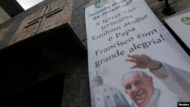 A banner promoting World Youth Day is seen at the Chapel of Sao Jeronimo, where Pope Francis is expected to visit during his upcoming trip to Varginha slum in Rio de Janeiro,Brazil, July 16, 2013.