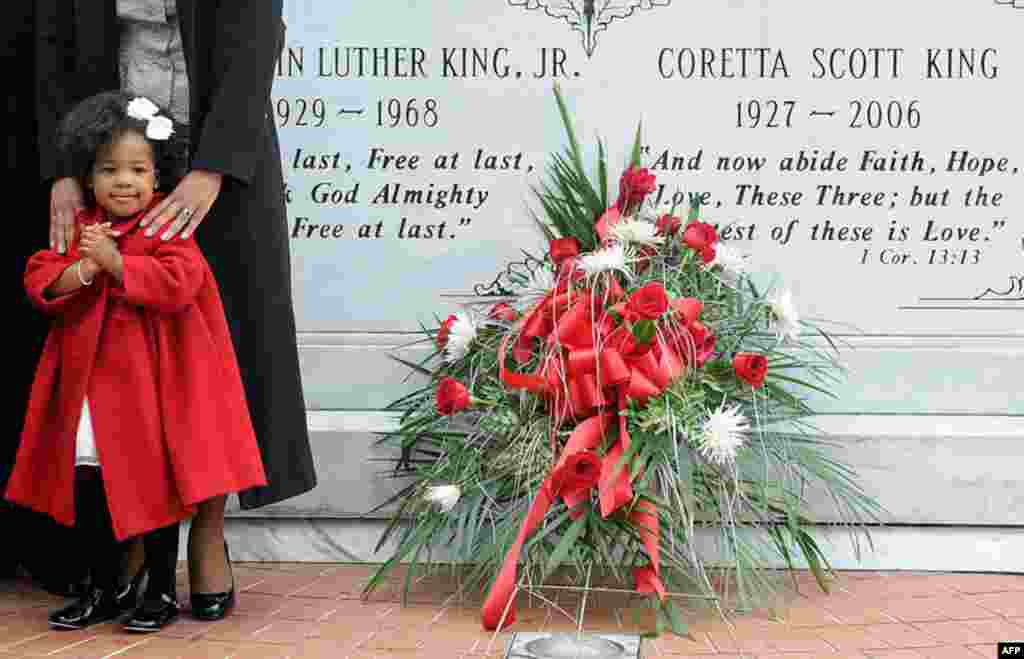January 17: Two-year-old Yolanda Renee King stands at the crypt of her grandparents, slain civil rights leader Martin Luther King, Jr. and Coretta Scott King, during a wreath laying ceremony on the 25th anniversary of the King Holiday in Atlanta, Georgia.