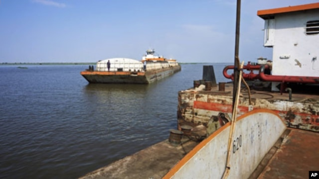 A barge with food and other imports arrives at the Nile port of Kosti at White Nile State, South Sudan, September 21, 2011.