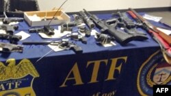 Des Weapons seized after hundreds of law enforcement officers raided homes on the east side of Los Angeles, searching for Big Hazard gang members with ties to the Mexican Mafia who have been indicted on federal racketeering charges, are on display at a...