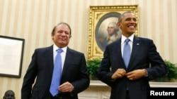 2013年10月23日,奥巴马总统(右)在白宫会见到访的巴基斯坦总理谢里夫(左)。