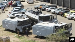 FILE - Zimbabwean riot police with water cannons are seen parked in Harare, Oct. 11, 2018. Lawyers say police in the country have arrested dozens of trade union members ahead of a planned protest in the capital over the worst economic crisis in a decade.