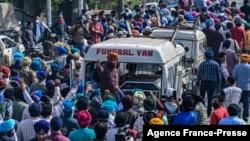 Mourners shout slogans during the funeral procession for slain school principal Supinder Kour, in Srinagar, Indian-administered Kashmir, Oct. 8, 2021.