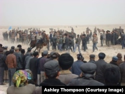 Ethnic Uyghurs compete in horse racing at a Nowruz event outside the city of Kuqa, in China's Xinjiang Uyghur Autonomous Region, March 21, 2011.