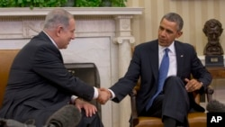 President Barack Obama and Israeli Prime Minister Benjamin Netanyahu shake hands during their meeting in the Oval Office of the White House in Washington.