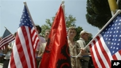 U.S. and Albanian flags (file)
