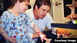 MusicianCorps founder Kiff Gallagher makes music with a patient at a San Francisco children's hospital. (Courtesy MusicianCorps)
