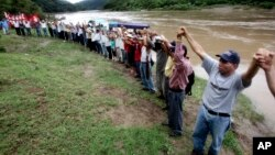 FILE - Honduras' largest tribe, the Lenca Indians, battles a proposed hydroelectric dam, Oct. 21, 2006. Lesbia Yaneth Urquia, who also fought the dam, killed by unidentified men, authorities said Thursday.