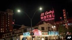 Two men walk past the El Cortez hotel-casino in downtown Las Vegas, Wednesday, Nov. 11, 2020. (AP Photo/Wong Maye-E)