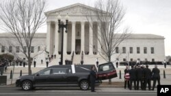 The body of Justice Antonin Scalia arrives at the Supreme Court in Washington, Feb. 19, 2016. Thousands of mourners will pay their respects to him Friday in the court building's Great Hall.