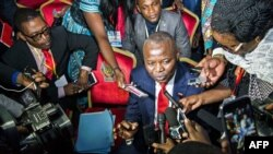 "FILE - Vital Kamerhe, president of the opposition Citizen Front Party (C) speaks to the media during the opening of a Congolese ""National Dialogue"" in the Democratic Republic of Congo's capital Kinshasa, Sept. 1, 2016."