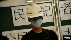 """香港民間記者會發言人王先生表示,8-18反送中流水式集會示範了香港人""""勇武有時、和理有時"""" 的公民質素。(美國之音湯惠芸拍攝)"""