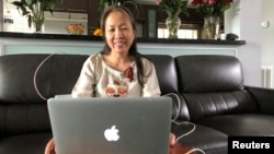 Vietnamese blogger-activist Mother Mushroom speaks with a reporter during a video conference on her laptop in Houston, Texas.