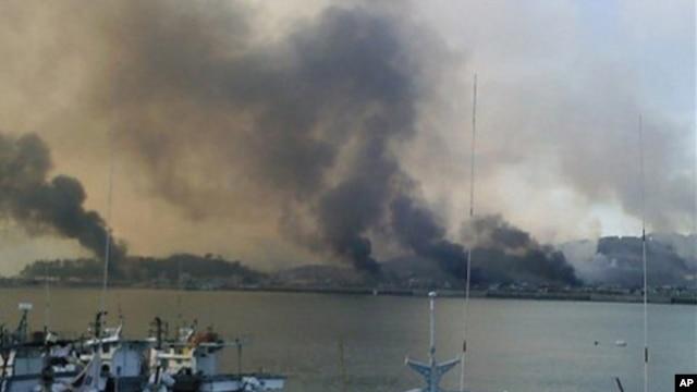 Smoke billow from Yeonpyeong island near the border against North Korea, in South Korea, 23 Nov 2010